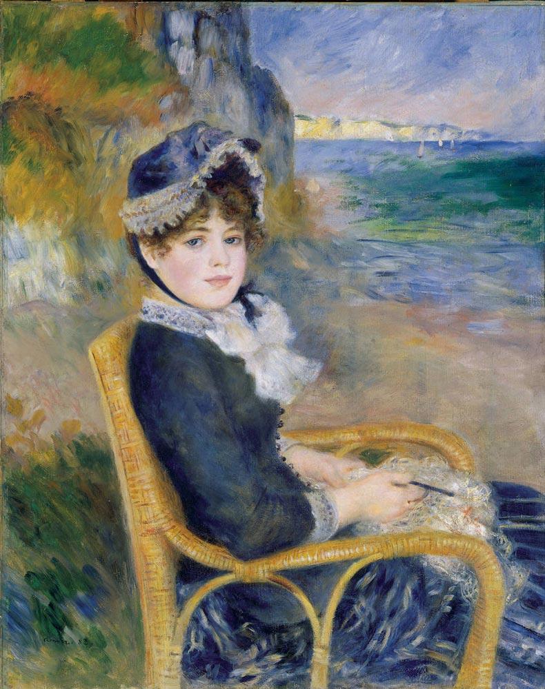Renoir che immortala una giovane ragazza seduta su una sedia di vimini
